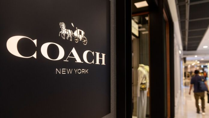 American multinational fashion and luxury accessories chain brand, Coach store, and logo seen in Hong Kong. (Budrul Chukrut/SOPA Images/LightRocket/Getty Images/CNN)