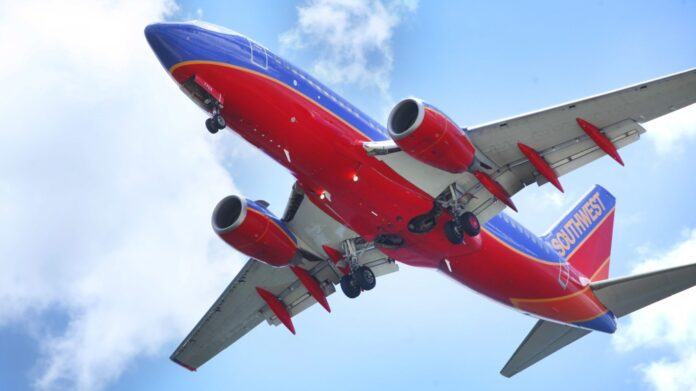 In a June 6, 2016, file photo, a Southwest Airlines jet gets ready to land at Tampa International Airport, in Tampa, Fla. (Skip O'Rourke/The Tampa Bay Times via AP, File)