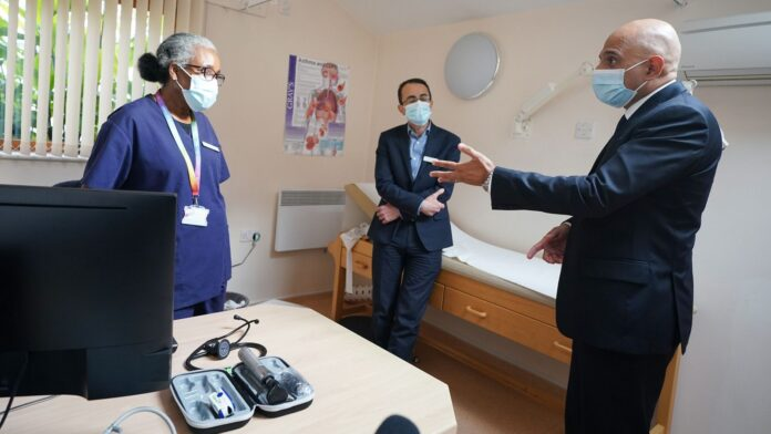 Health Secretary Sajid Javid meeting Dr Clementine Olenga-Disashi (left) and Dr Ali al-Bassam, during a visit to the Vale Medical Centre in Forest Hill, south east London